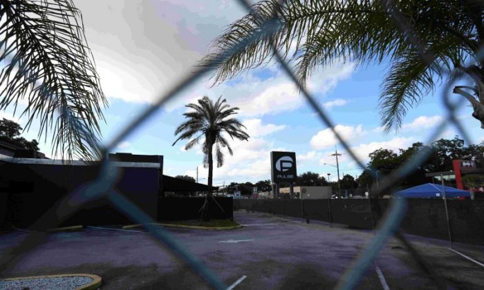The Pulse night club sign is pictured through a fence following the mass shooting there last week in Orlando, Fla., on June 21, 2016. (REUTERS/Carlo Allegri)