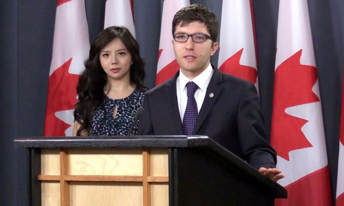 Conservative MP Garnett Genuis speaking at the National Press Theatre in Ottawa on April 4, 2017, with Miss World Canada Anastasia Lin on the left. (NTD Television)