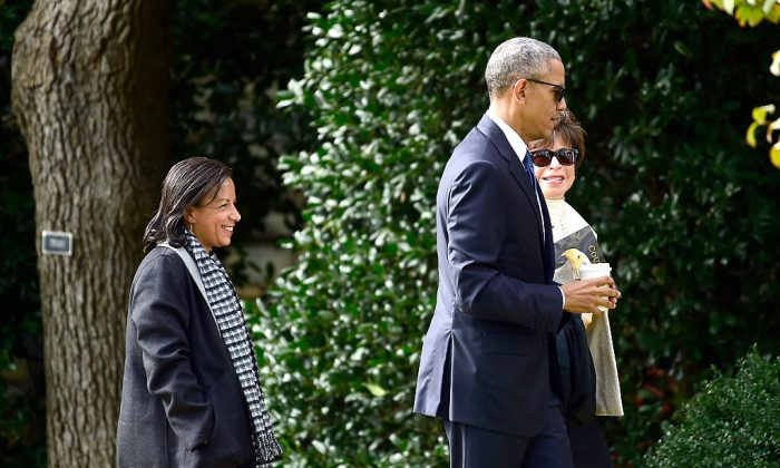 Former President Barack Obama returns to the White House with National Security Advisor Susan Rice (L) and Senior Advisor and Assistant to the President, White House Valerie Jarrett (R) after making remarks at Arlington National Cemetery in Arlington, Virginia on Nov.11, 2016. (Ron Sachs-Pool/Getty Images)