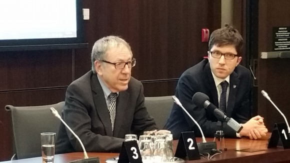 Former Liberal justice minister Irwin Cotler and Conservative MP Garnett Genuis speak after the screening of