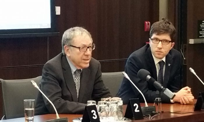 "Former Liberal justice minister and attorney general Irwin Cotler and Conservative MP Garnett Genuis speak after the screening of ""The Bleeding Edge"" in Ottawa on April 4, 2017. Genuis and Cotler are among co-chairs of the recently formed Inter-Parliamentary Alliance on China. (The Epoch Times)"