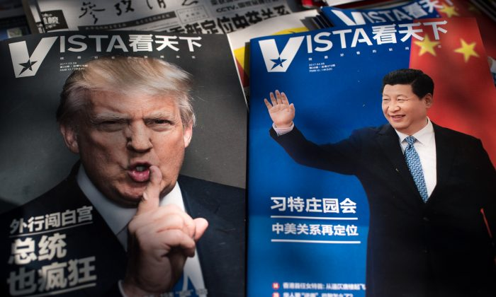 """Magazines featuring front pages of US President Donald Trump (L) and China's President Xi Jinping (R) are displayed at a news stand in Beijing on April 6, 2017. The first summit between US President Donald Trump and his Chinese counterpart Xi Jinping will be of """"great significance"""" for global peace, the two countries' top diplomats agreed ahead of the meeting. The two meet at Trump's Mar-a-Largo resort in Florida on April 6 and 7.  (NICOLAS ASFOURI/AFP/Getty Images)"""