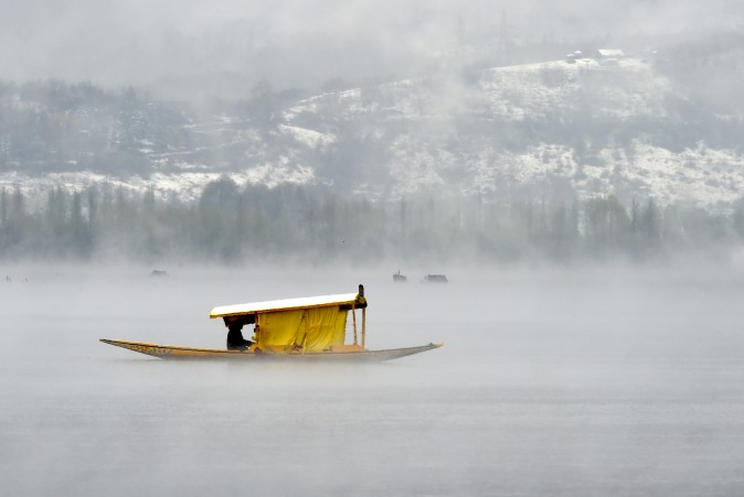 Kashmiri boatmen paddle a shikara across Dal Lake in Srinagar, India, on April 6, 2017. (Tauseef Mustafa/AFP/Getty Images)