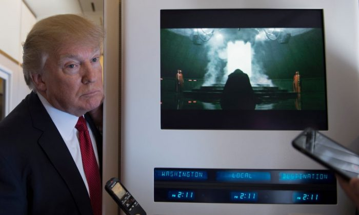 US President Donald Trump speaks to the press on Air Force One on April 6, 2017. (JIM WATSON/AFP/Getty Images)