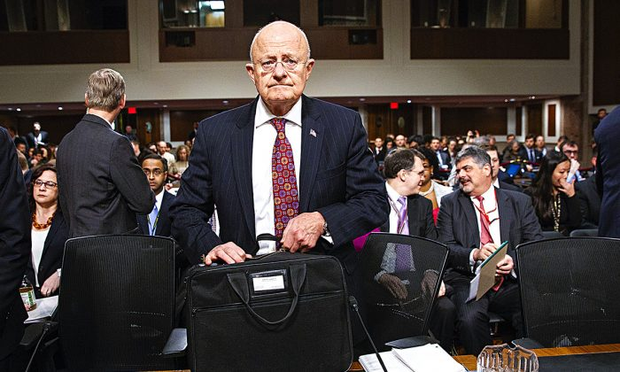 Former Director of National Intelligence James Clapper arrives on Capitol Hill to testify before the Senate Armed Services Committee on Jan. 5. (AP PHOTO/EVAN VUCCI)