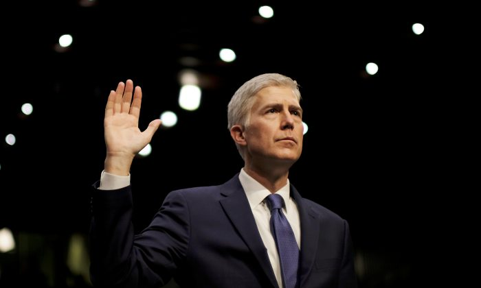 Supreme Court nominee judge Neil Gorsuch is sworn in to testify at his confirmation hearing. (REUTERS/James Lawler Duggan)