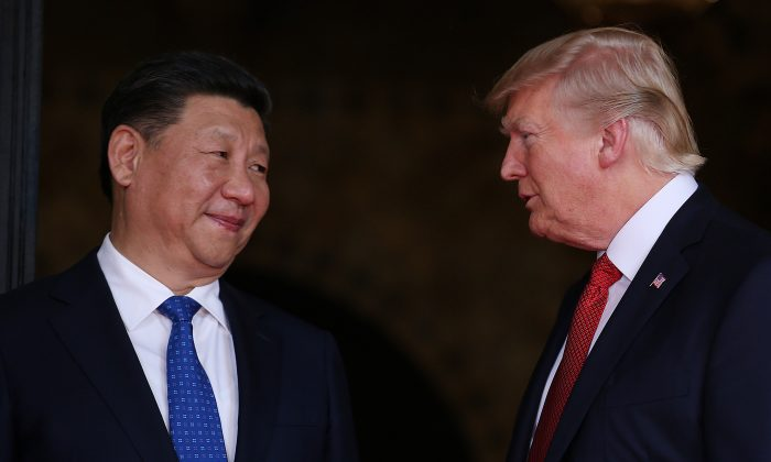 President Trump welcomes Chinese President Xi Jinping at Mar-a-Lago state in Palm Beach, Florida. (REUTERS/Carlos Barria)