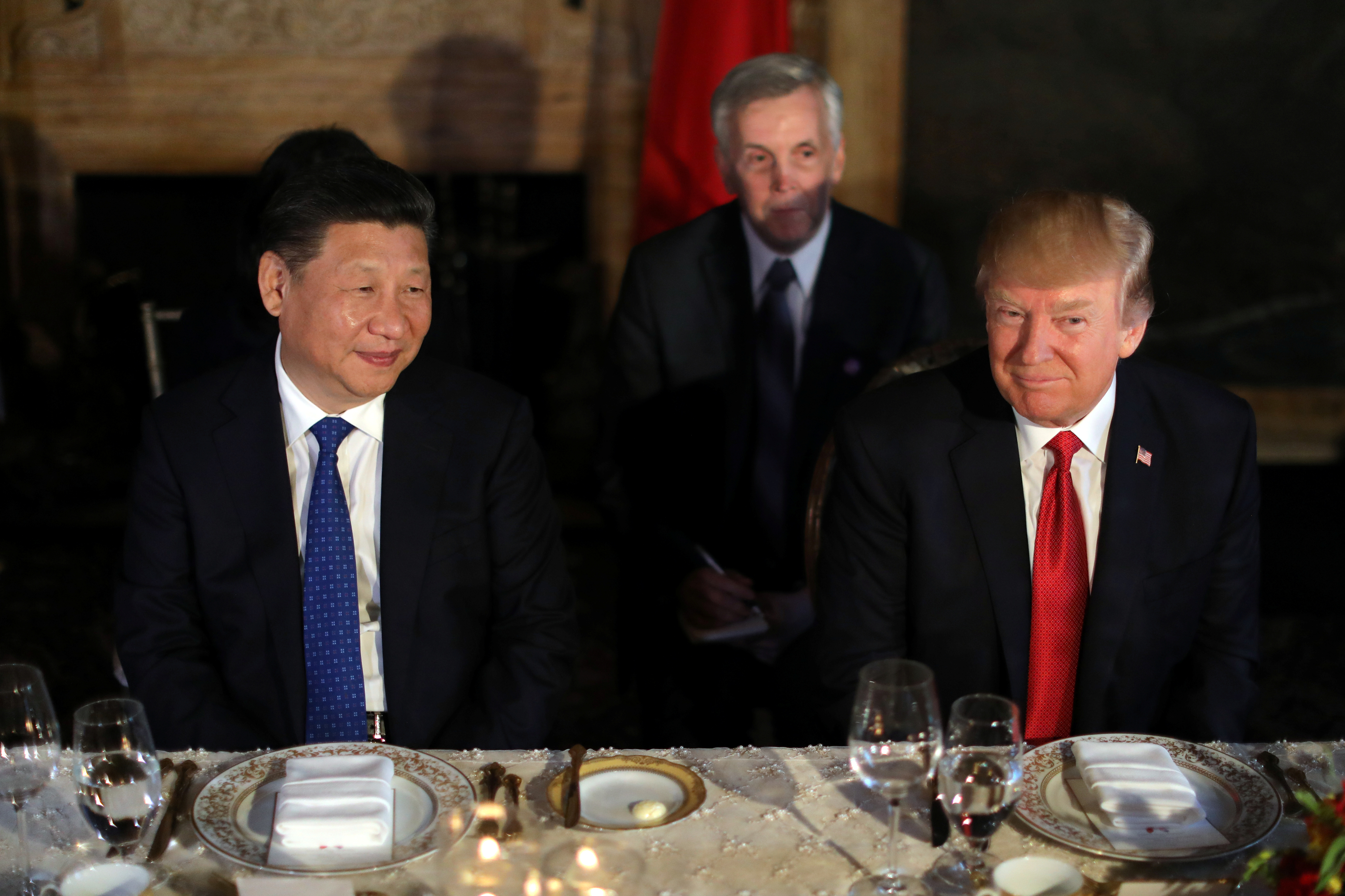 Chinese leader Xi Jinping and President Donald Trump attend a dinner at the start of their summit at Trump's Mar-a-Lago estate in West Palm Beach, Florida. (REUTERS/Carlos Barria)