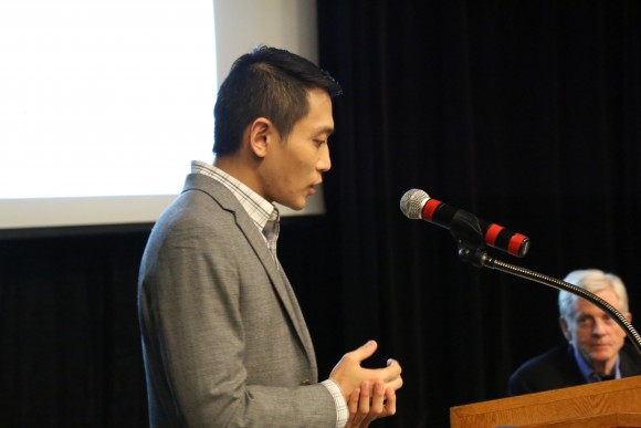 Professor Y.Y. Chen speaks to the audience as the moderator of the panel discussion following the screening of