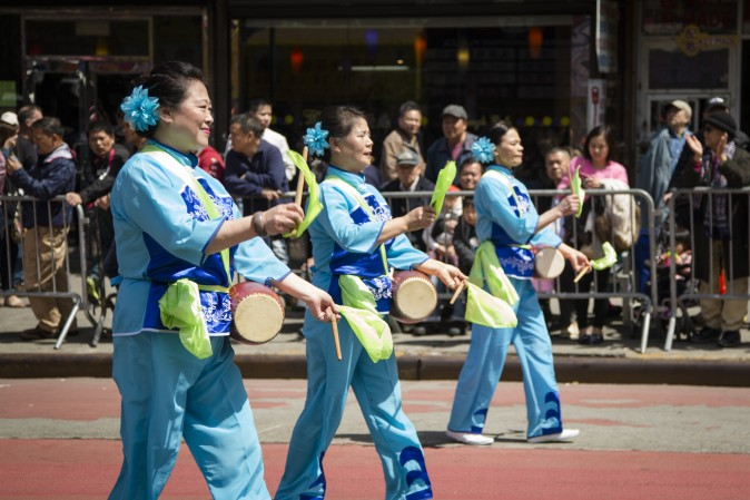 A waist drum troupe, made up of Falun Gong practitioners, marches in a parade in Flushing, New York, on April 23, 2017, to commemorate the 18th anniversary of the April 25th peaceful appeal of 10,000 Falun Gong practitioners in Beijing. (Samira Bouaou/The Epoch Times)