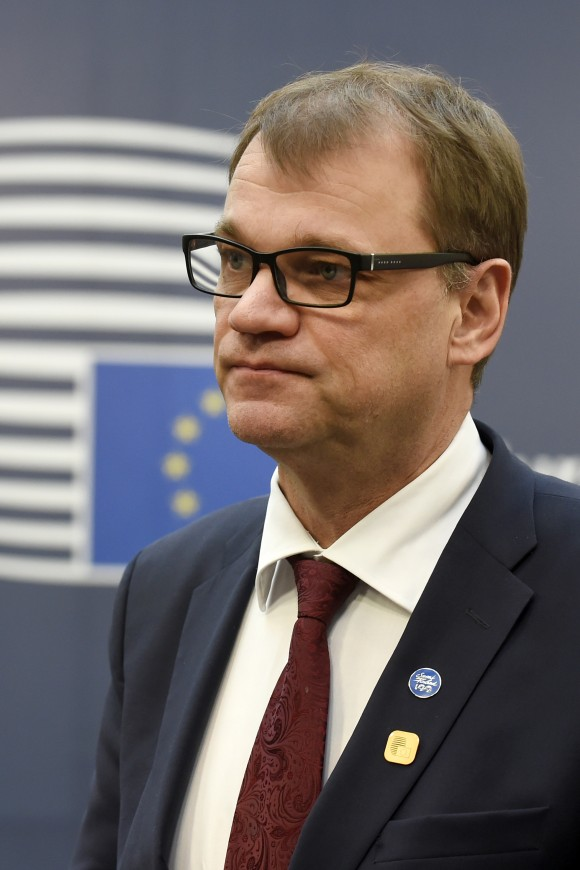 Finland's Prime minister Juha Sipila addresses the media as he arrives for a European Union leaders summit focused on Russia sanctions and migration at the European Council in Brussels on Dec. 15, 2016. (JOHN THYS/AFP/Getty Images)