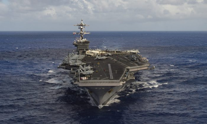 The aircraft carrier USS Carl Vinson (CVN 70) transits the Pacific Ocean January 30, 2017.  (U.S. Navy Photo by Mass Communication Specialist 3rd Class Tom Tonthat/Handout via Reuters)