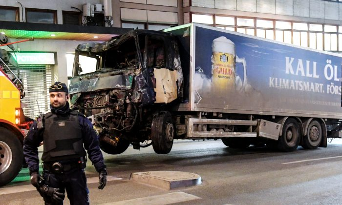 Tow trucks pull away the beer truck that crashed into the department store Ahlens after plowing down the Drottninggatan Street in central Stockholm, Sweden on April 8, 2017. (Maja Suslin/TT News Agency/via Reuters)