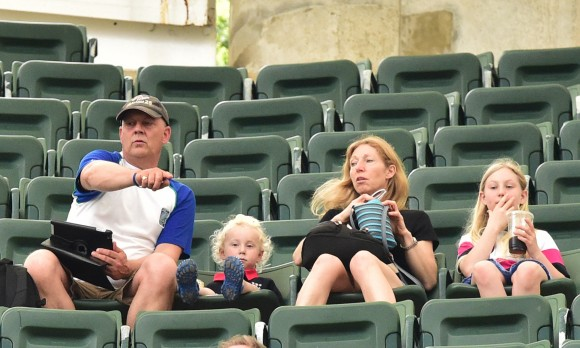 Sitting high in the East Stand, well away from the crowds, even the youngsters are interested in the Hong Kong Sevens action. Youngsters under the age of 3 years gain free entry to the Sevens. (Bill Cox/Epoch Times)