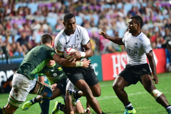 Mesulame Kunavula of Fiji pushes forward to score their 2nd try in the Cathay Pacific/HSBC Sevens final at HK Stadium So Kon Po on Sunday April 9, 2017. (Bill Cox/Epoch Times)