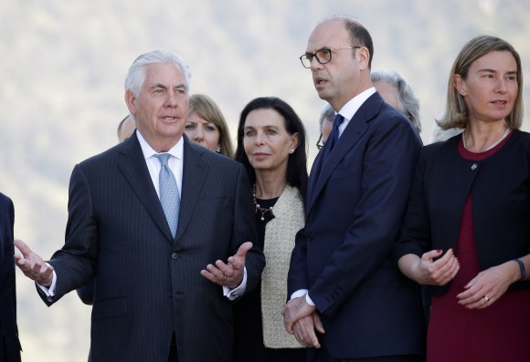 Secretary of State Rex Tillerson (L) gestures as he talks with Italy's Foreign Minister Angelino Alfano (C) and E.U. High Representative for Foreign Affairs Federica Mogherini (R) during a ceremony at the Sant'Anna di Stazzema memorial, dedicated to the victims of the massacre committed in the village of Sant'Anna di Stazzema by the Nazis in 1944 during World War II, Italy April 10, 2017. (REUTERS/Max Rossi)