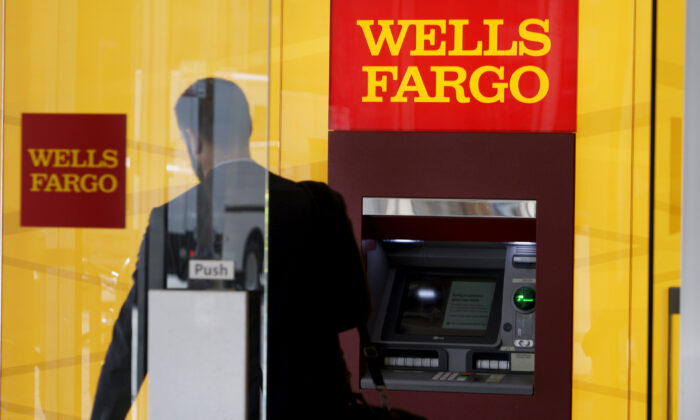 A man walks by a bank machine at the Wells Fargo & Co. bank in downtown Denver, Colo., on April 13, 2016. (Rick Wilking via Reuters)