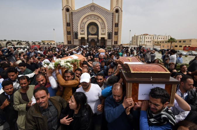 Mourners carry the coffins of victims of the suicide bombing that occurred the previous day at the Coptic Christian Saint Mark's Church, killing at least 44, during a funeral procession in Borg El-Arab, Egypt, on April 10, 2017. (Mohamed El-Shahed/AFP/Getty Images)