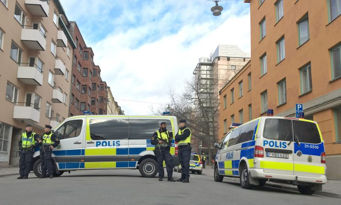 Policemen guard next to the court before the detention hearing of suspect in Friday's attack in Stockholm, Sweden on April 11, 2017. (REUTERS/Anna Ringstrom)