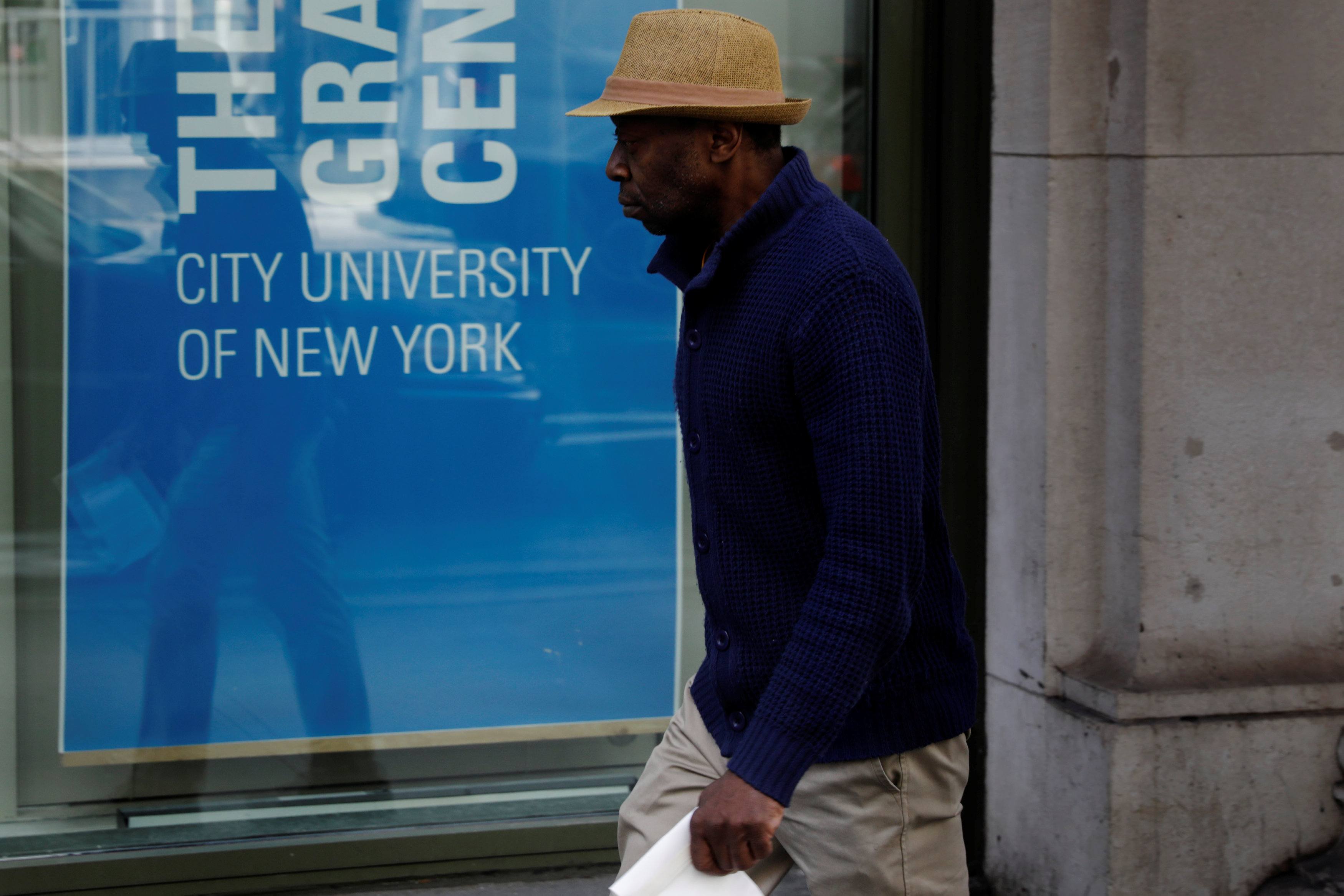 A pedestrian walks past a City University of New York building in New York on April 11, 2017. (REUTERS/Lucas Jackson)