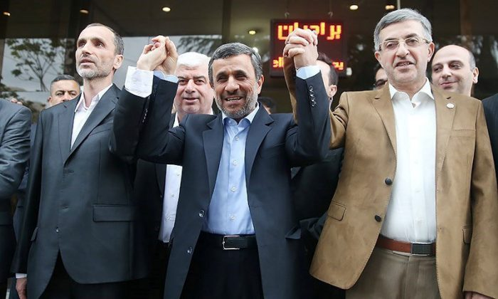 Ex-Iranian President Mahmoud Ahmadinejad (C)  submits his name for registration as a candidate in Iran's presidential election, in Tehran, Iran on April 12, 2017. (Tasnim News Agency/Handout via REUTERS)