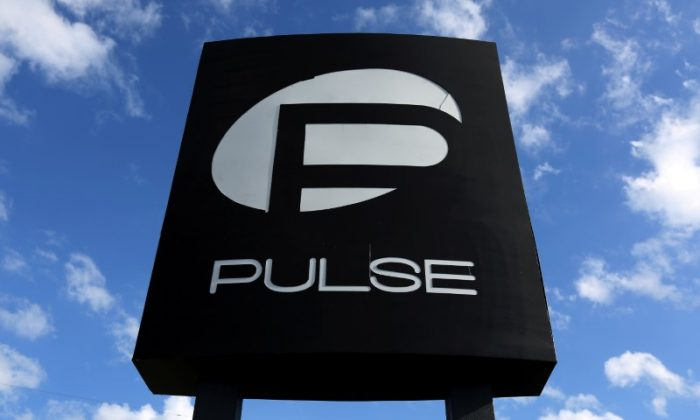The Pulse nightclub sign is pictured following the mass shooting in Orlando, Fla., on June 21, 2016. (REUTERS/Carlo Allegri)