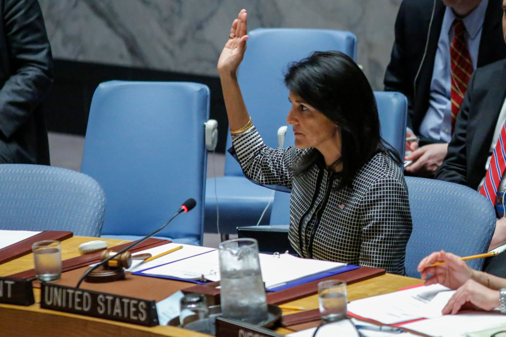 US Ambassador to the UN Nikki Haley holds up her hand as she votes in favor on a Draft resolution that condemns the reported use of chemical weapons in Syria at the Security Council  at UN Headquarters in New York on April 12, 2017. (KENA BETANCUR/AFP/Getty Images)