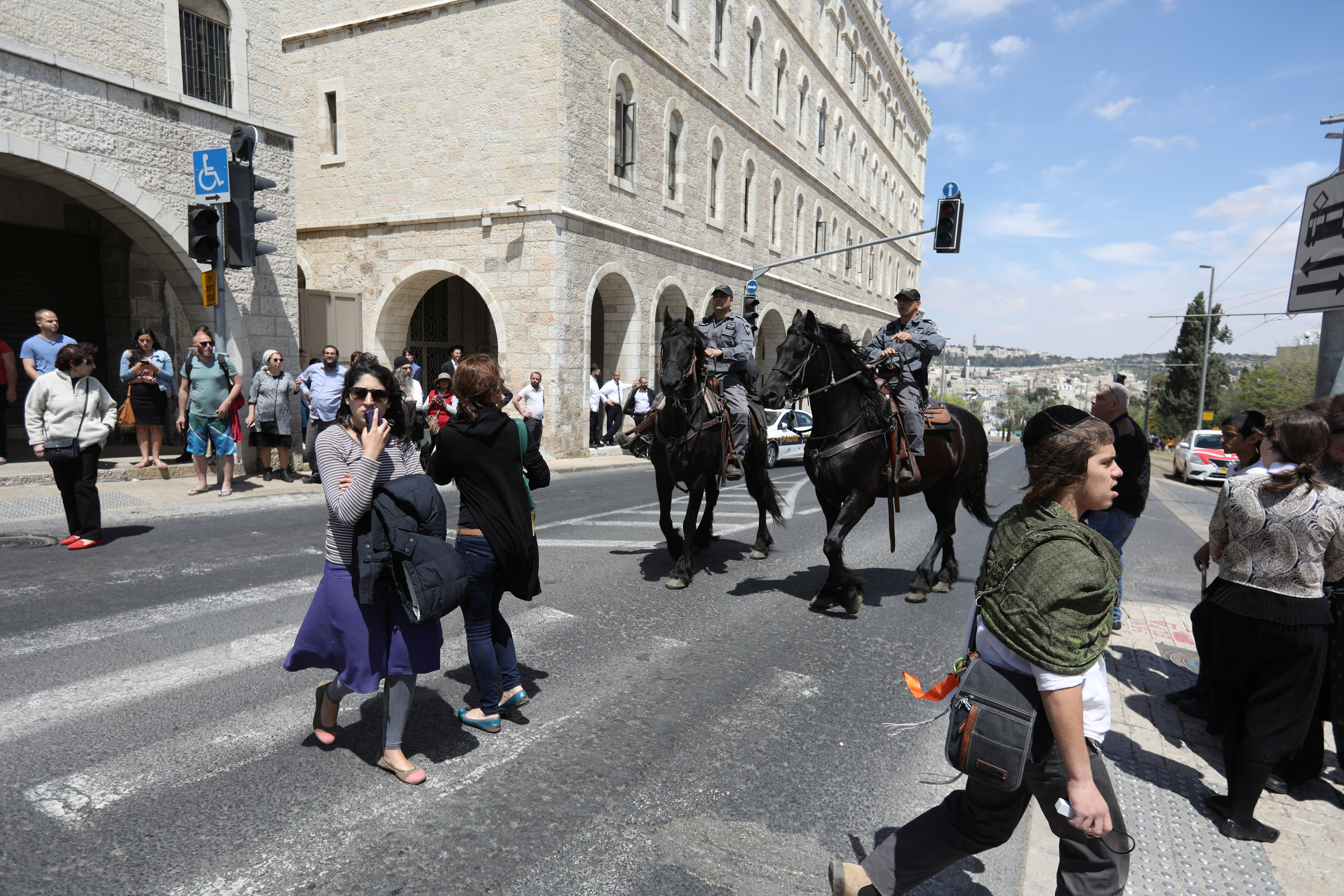 Israeli policemen on horses keep the order following a stabbing attack just outside Jerusalem's Old City, according to Israeli police on April 14, 2017. (REUTERS/Ammar Awad)