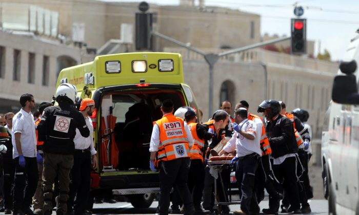 Israeli medics evacuate an injured person following a stabbing attack just outside Jerusalem's Old City, according to Israeli police on April 14, 2017. (REUTERS/Ammar Awad)