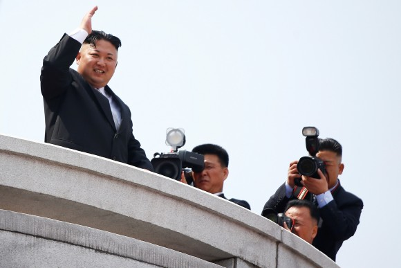North Korean leader Kim Jong Un waves to people attending a military parade marking the 105th birth anniversary of country's founding father Kim Il Sung, in Pyongyang April 15, 2017. REUTERS/Damir Sagolj)