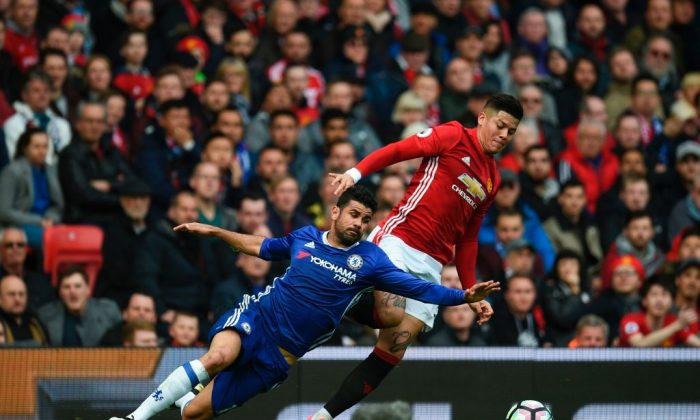 Chelsea's Brazilian-born Spanish striker Diego Costa (L) vies with Manchester United's Argentinian defender Marcos Rojo during the English Premier League football match between Manchester United and Chelsea at Old Trafford in Manchester, England, on April 16, 2017. (Oli Scarff/AFP/Getty Images)