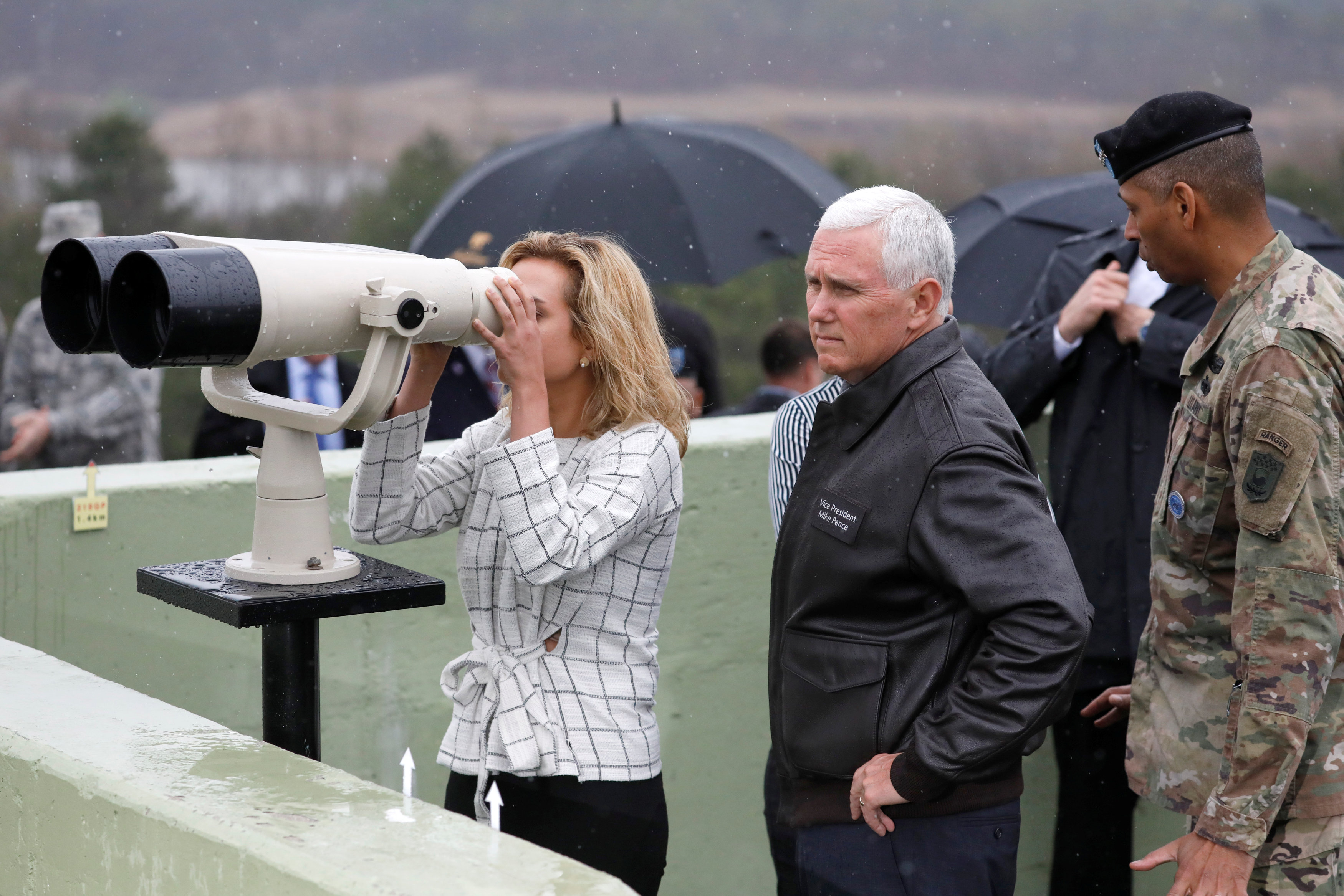 U.S. Vice President Mike Pence stands next to his daughter looking toward the north through a pair of binocular from an observation post inside the demilitarized zone separating the two Koreas, in Paju, South Korea on April 17, 2017.  (REUTERS/Kim Hong-Ji)