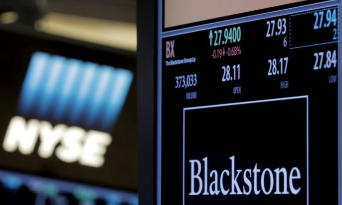 FILE PHOTO -  The ticker and trading information for Blackstone Group is displayed at the post where it is traded on the floor of the New York Stock Exchange (NYSE) on April 4, 2016. (REUTERS/Brendan McDermid)