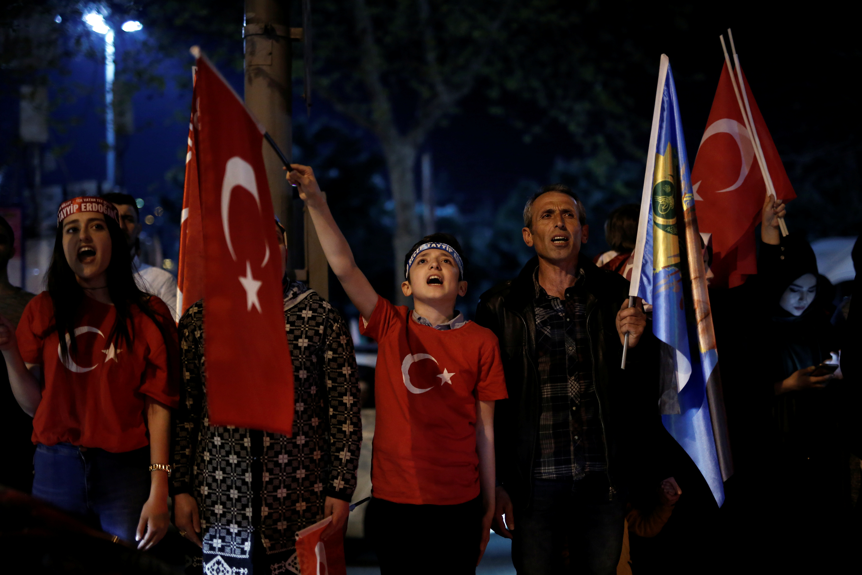 Supporters of Turkish President Tayyip Erdogan chant the national anthem as they celebrate in Istanbul. (REUTERS/Alkis Konstantinidis)