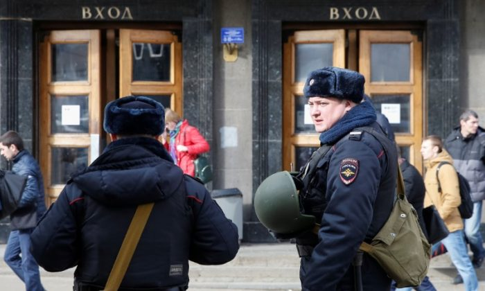 Police officers stay in front of a metro station following the St. Petersburg metro blast that took place on April 3, in Moscow, Russia on April 5, 2017. (REUTERS/Maxim Shemetov)