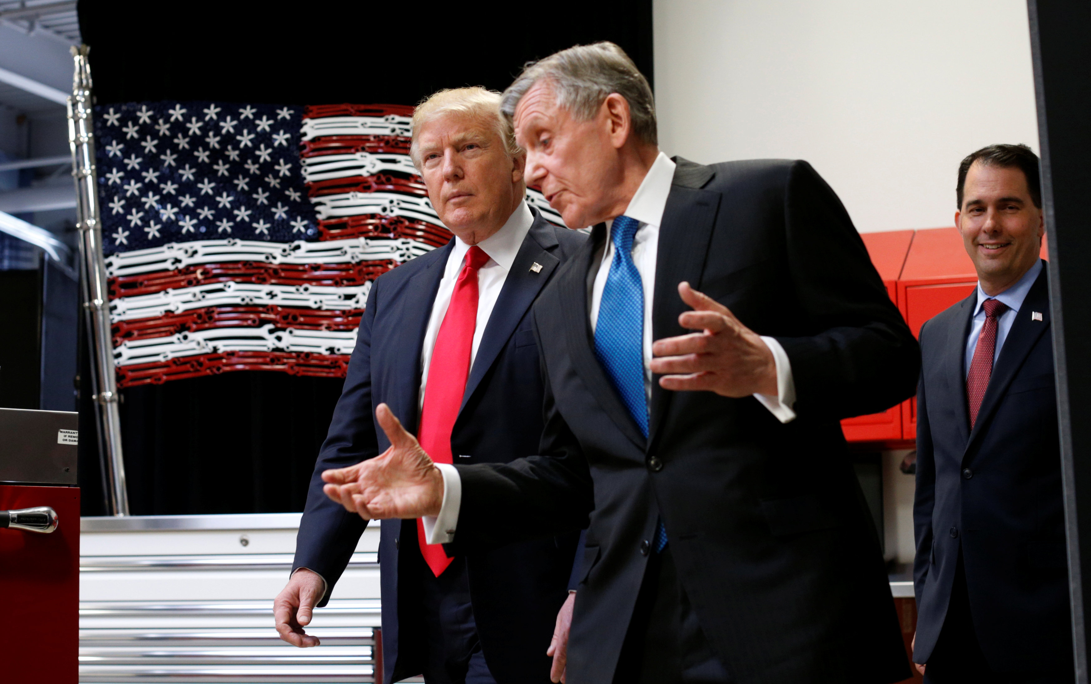 President Donald Trump tours the world headquarters of Snap-On Inc with CEO Nick Pinchuk (C) as Wisconsin Governor Scott Walker (R) follows, in Kenosha, Wis., on April 18, 2017. (REUTERS/Kevin Lamarque)