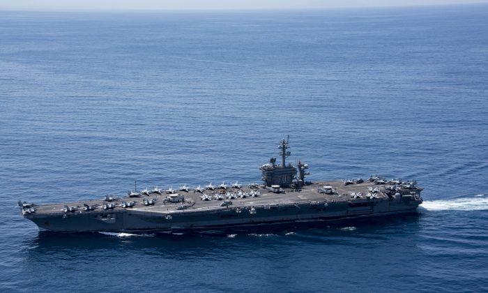 The aircraft carrier USS Carl Vinson (CVN 70) transits the Indian Ocean on April 15, 2017. (U.S. Navy photo by Mass Communication Specialist 3rd Class Matt Brown/Handout via REUTERS)