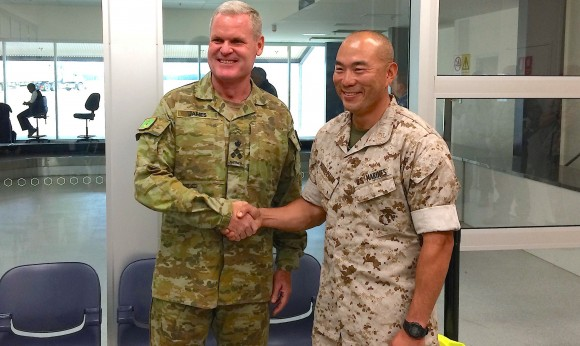 U.S. Marines commander Lieutenant Colonel Brian Middleton (R) shakes hands with Australian Army Brigadier Ken James after arriving for the sixth annual Marines' deployment at Darwin in northern Australia, April 18, 2017. (REUTERS/Tom Westbrook)