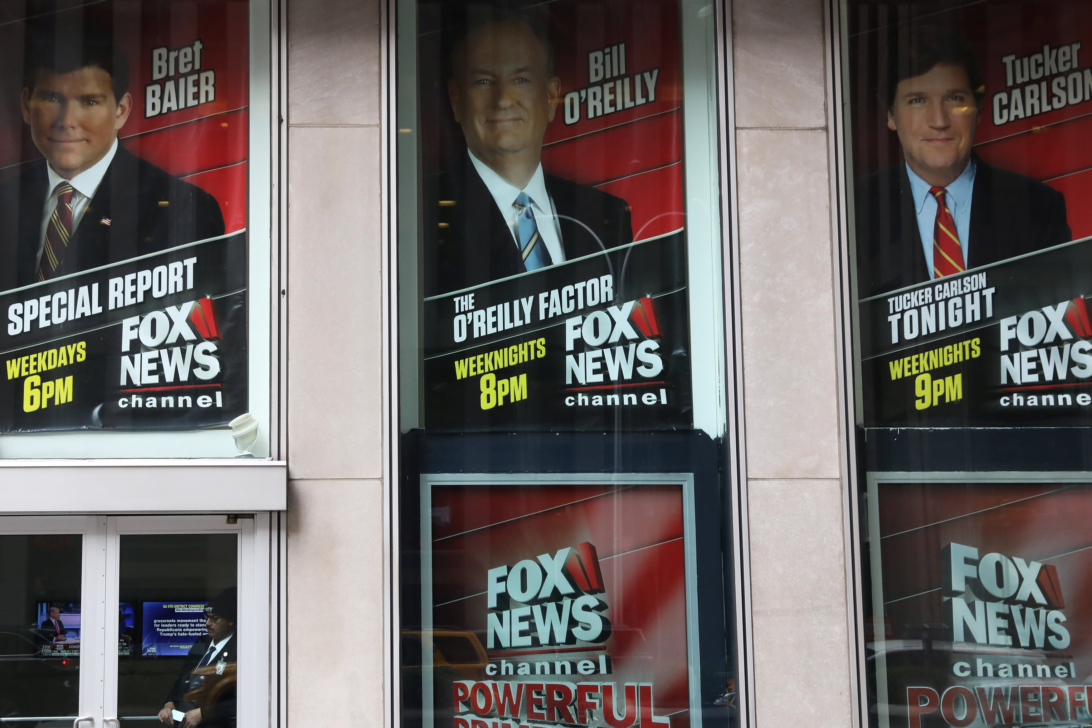 Posters featuring Fox News talent, including Bill O'Reilly, outside the News Corporation headquarters in New York. (REUTERS/Shannon Stapleton)