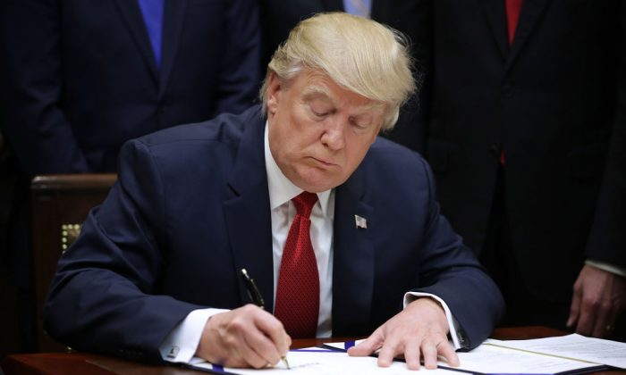 President Donald Trump signs the Veterans Choice Program And Improvement Act in the Roosevelt Room at the White House in Washington on April 19, 2017. (Chip Somodevilla/Getty Images)
