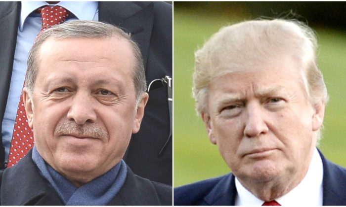 (L) Turkish President Tayyip Erdogan greets supporters at Ankara Esenboga Airport in Ankara, Turkey, on April 17, 2017.