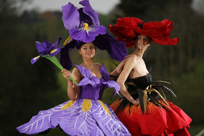 Models Lauren Green (L) and Abi Moore wear an Iris and Poppy flower gowns designed by New Zealand artist Jenny Gillies in Harrogate, England, on April 19, 2017. The flower gowns are just some of the many dresses being displayed at this year's Harrogate Spring Show. (Christopher Furlong/Getty Images)