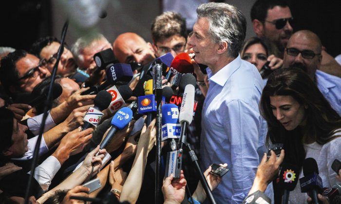 Mauricio Macri speaks to the press after voting in Buenos Aires, Argentina, on Nov. 22, 2015. In his first 16 months in office, Macri has pushed through many tough reforms. (EITAN ABRAMOVICH/AFP/GETTY IMAGES)