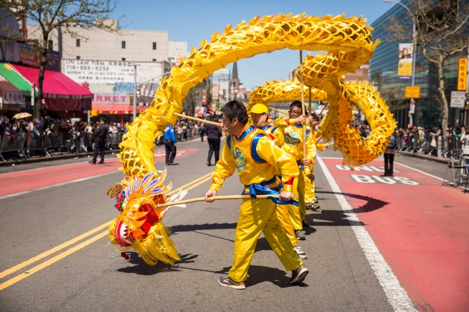Falun Gong practitioners march in a parade in Flushing, New York, on April 23, 2017, to commemorate the 18th anniversary of the April 25th peaceful appeal of 10,000 Falun Gong practitioners in Beijing. (Benjamin Chasteen/The Epoch Times)