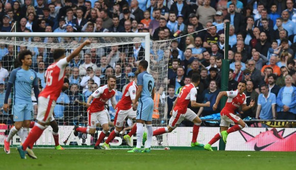 Alexis Sanchez (1st R) of Arsenal celebrates scoring his side's second goal during the Emirates FA Cup Semi-Final match between Arsenal and Manchester City at Wembley Stadium on April 23, 2017 in London, England. (Shaun Botterill/Getty Images).