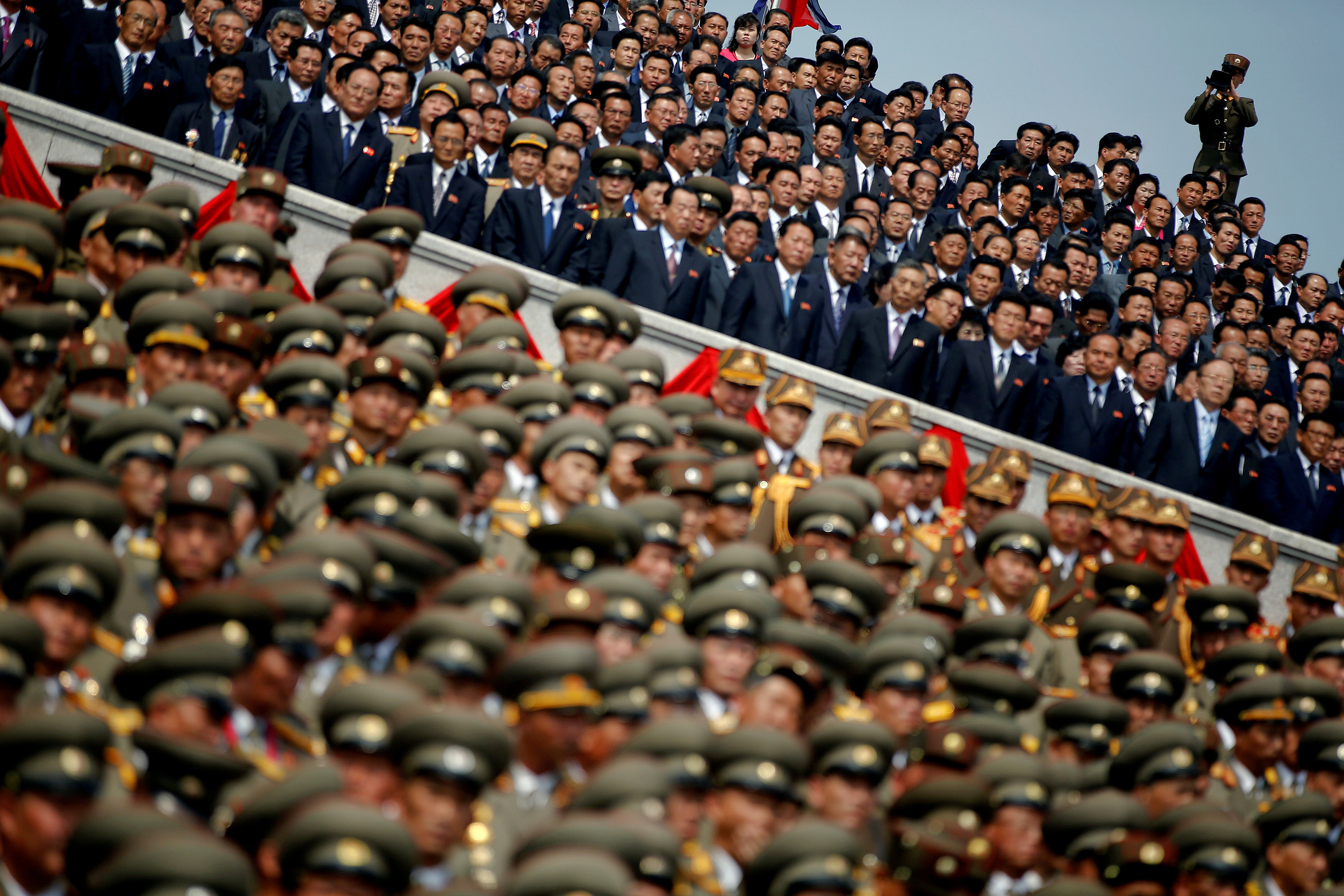 A soldier films North Korean soldiers, officers and high ranking officials attending a military parade marking the 105th birth anniversary of country's founding father Kim Il Sung in Pyongyang, North Korea on April 15, 2017. (REUTERS/Damir Sagolj)