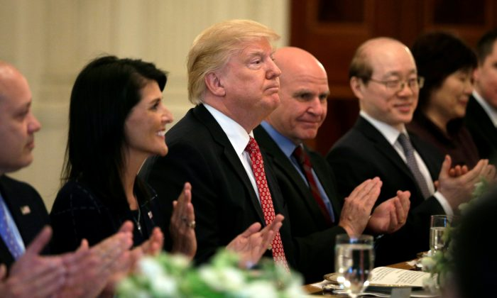 With U.S. Ambassador to the United Nations Nikki Haley at his side (L), President Donald Trump receives applause after speaking at a working lunch with ambassadors of countries on the UN Security Council at the White House in Washington on April 24, 2017.  (REUTERS/Kevin Lamarque)