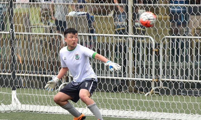 KCC Knights goalie , Wong Chi Chuen has little time to react from this penalty kick taken by Antoine Gael Sahagian of Club Albion in the Yau Yee League Division 1 match  at Sports Road on Sunday April 23, 2017.League leaders Albion dominated the game winning 6-0. (Bill Cox/Epoch Times)