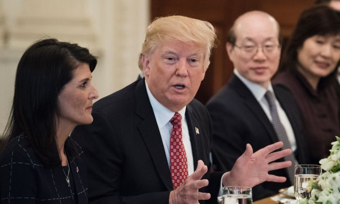 US Ambassador to the UN Nikki Haley (L) and China's Ambassador to the UN Liu Jieyi (2R)  listens while US President Donald Trump (2L) speaks before a working lunch with UN Security Council member nations in the State Dining Room of the White House  in Washington on April 24, 2017. (BRENDAN SMIALOWSKI/AFP/Getty Images)