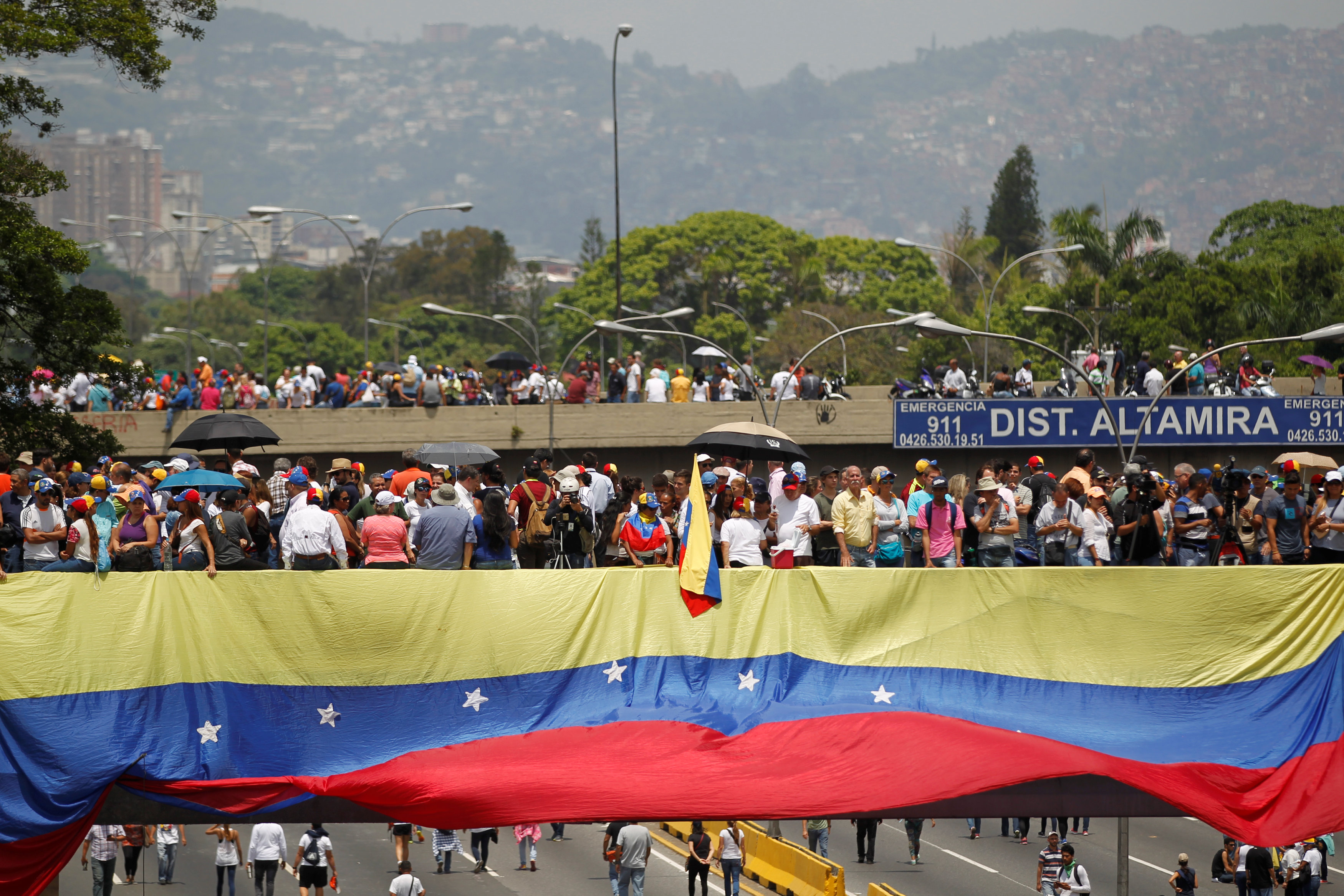 Protestors attend a rally against Venezuela's Socialist leader Nicolas Maduro in Caracas, Venezuela on April 24, 2017. (REUTERS/Christian Veron)
